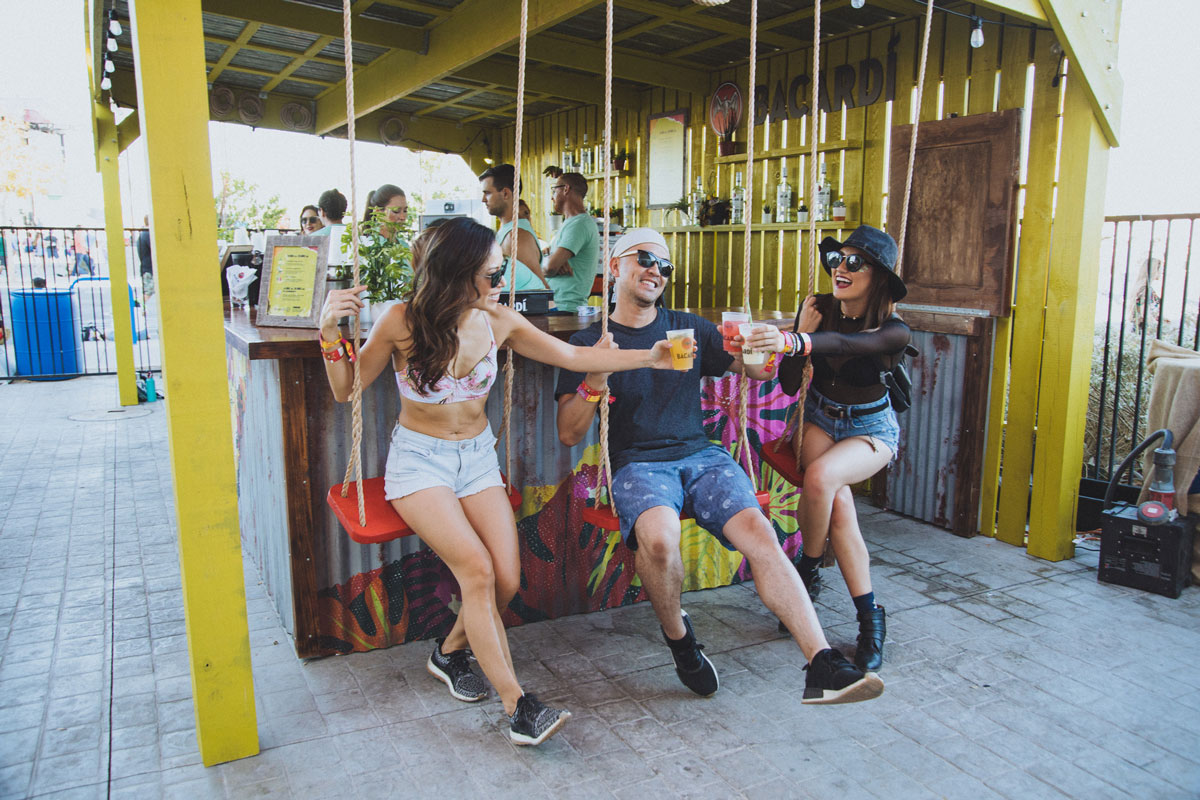 Festival goers cheers by event photographer