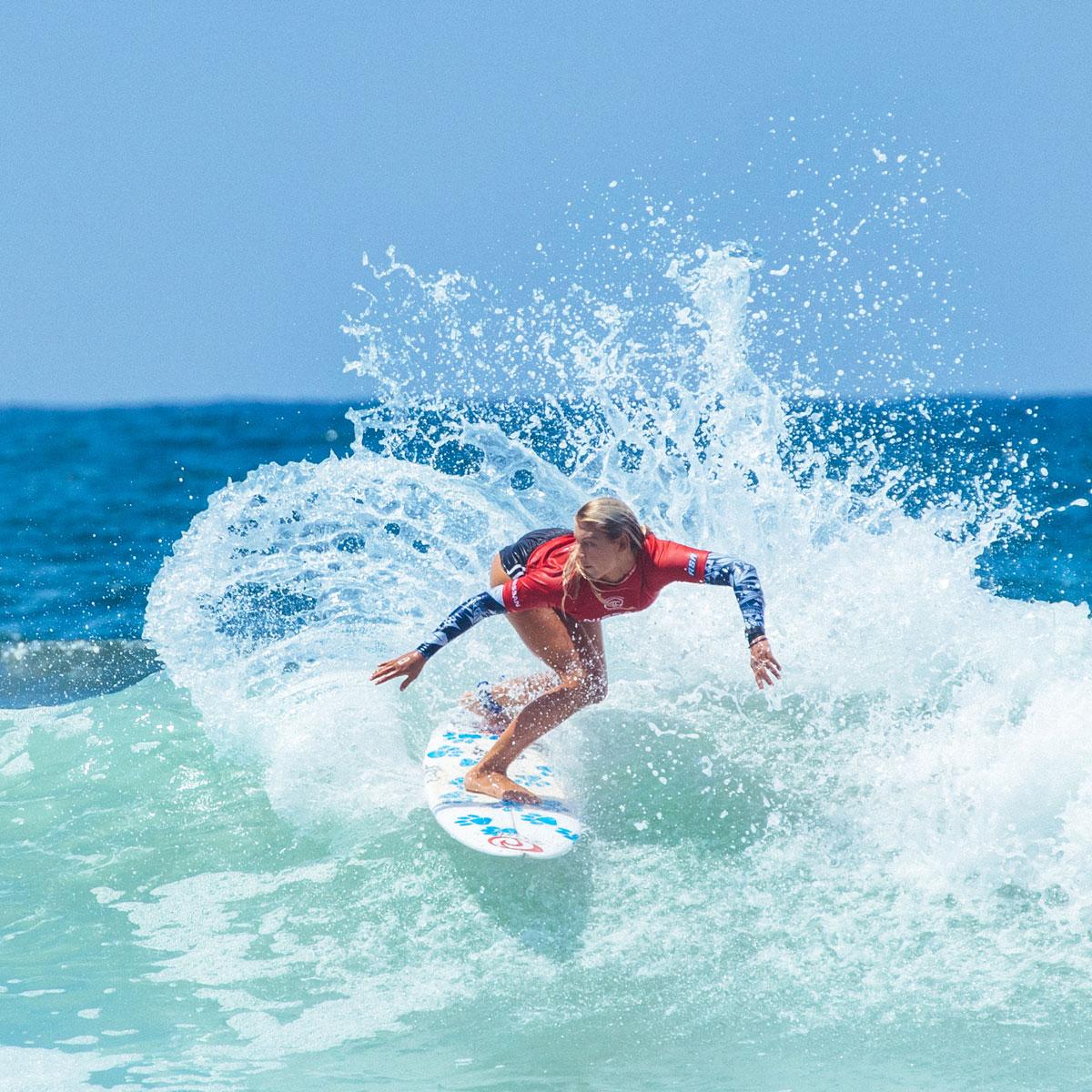Female Surfer cutting wave