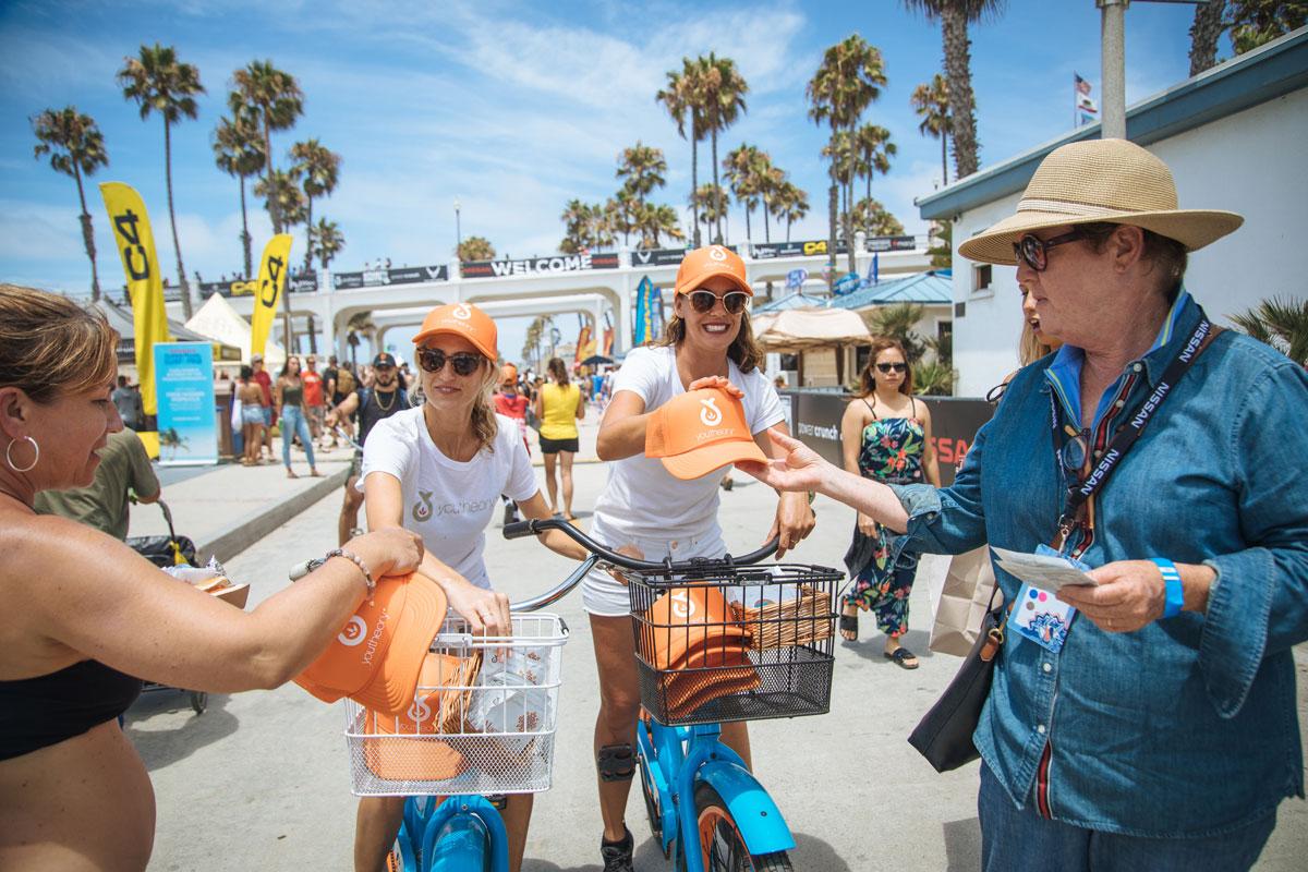 Brand Ambassadors handing out hats